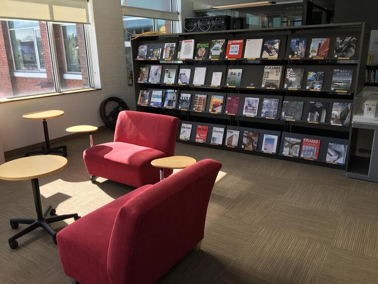 South east reading corner of Musagetes Library with journals displayed in background.