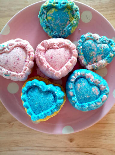 heart shaped bath bombs on a plate