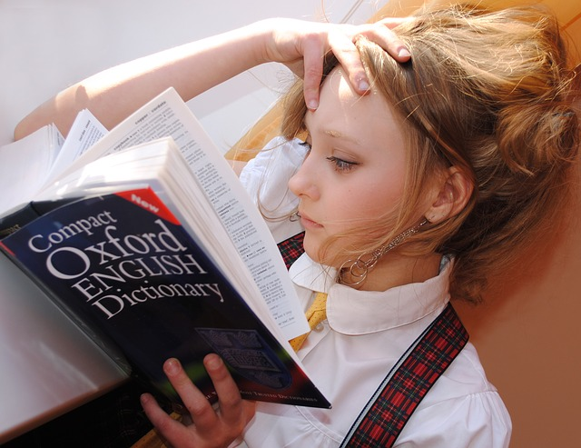 school girl reading dictionary