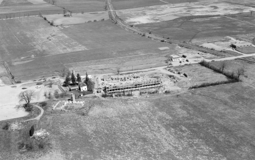 aerial view of Schweitzer Farmhouse (now Grad House)