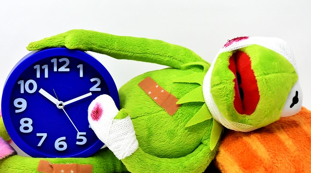 Kermit bleeding holding clock