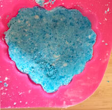 blue ingredients in a heart shaped mold
