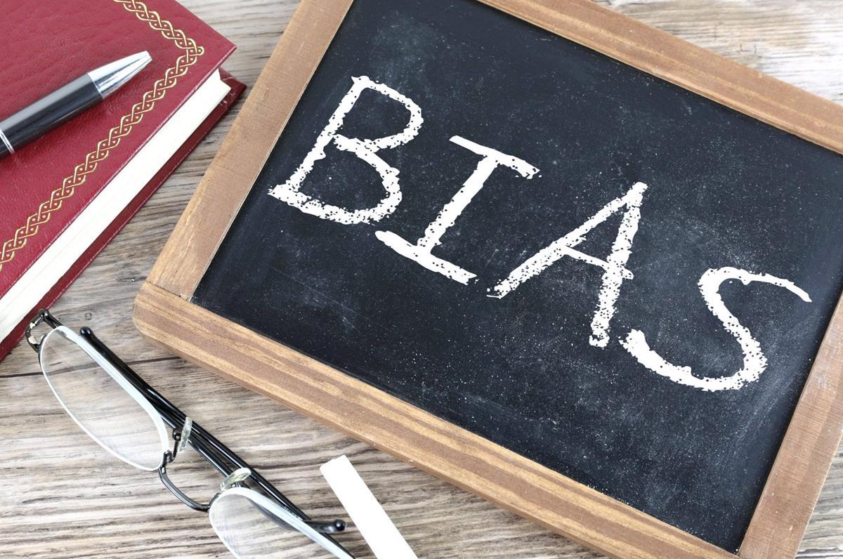 the word bias writen on a chalk board
