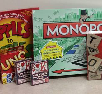 Variety of board games including Uno, Monopoly, and playing cards