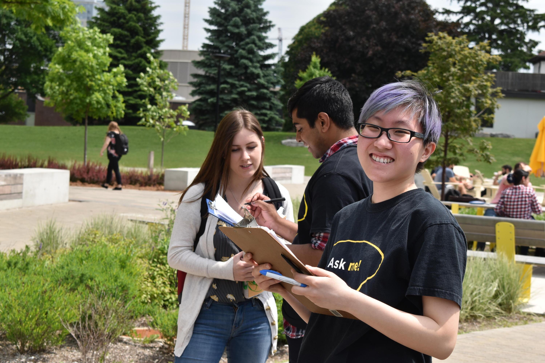 Ambassadors talking to students