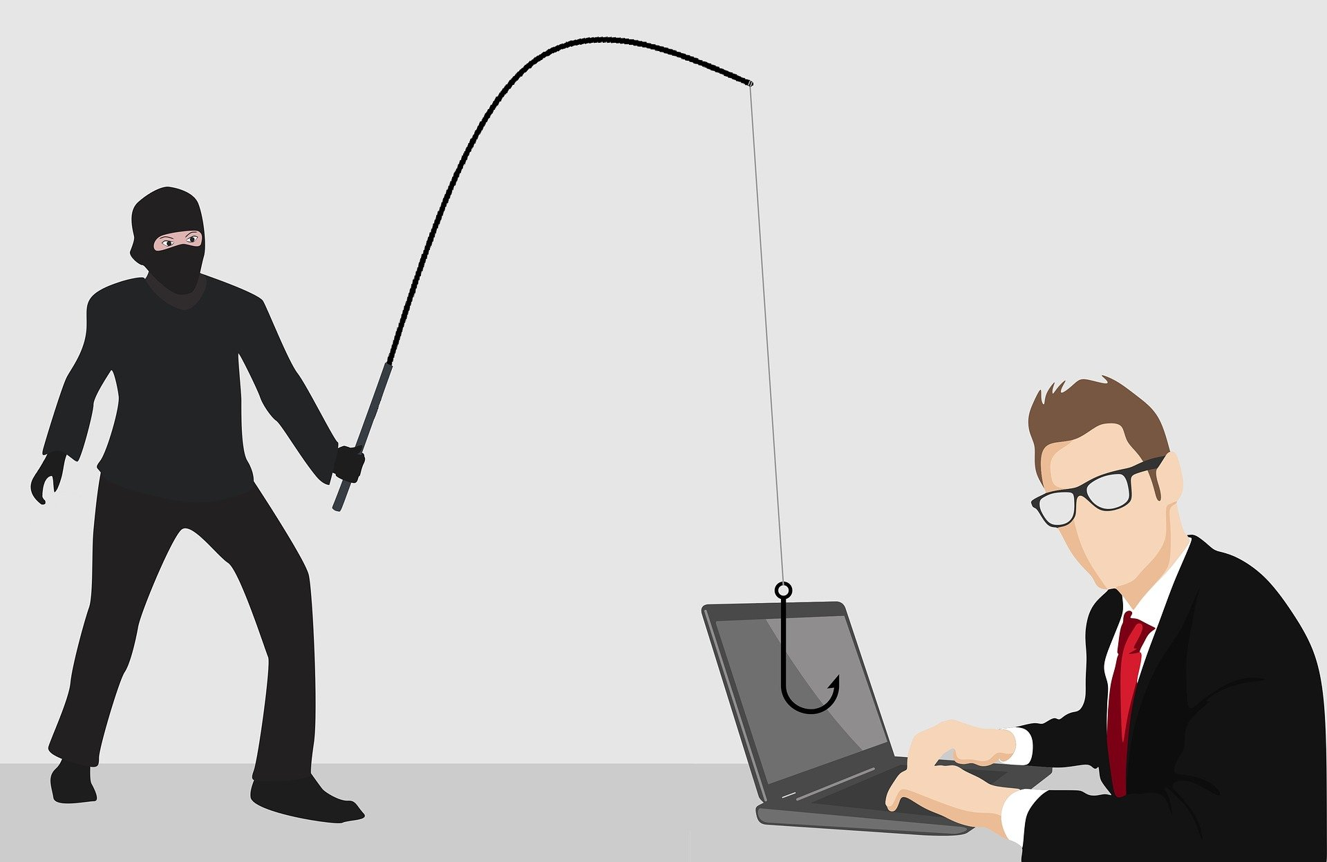person with a fishing rod dangling it in front of man at computer