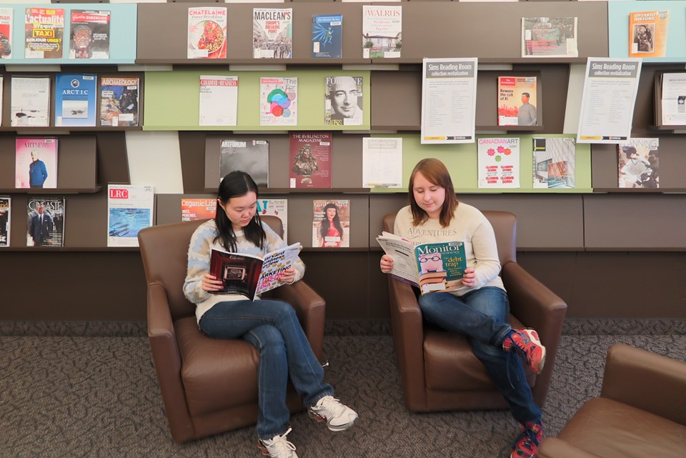 Students reading magazines