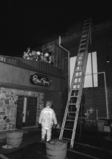 Firemen on roof above Royal Room
