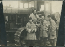 Harry Byers and students in front of a tractor
