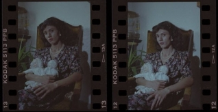 Negatives of unknown woman posing with dolls in her lap.