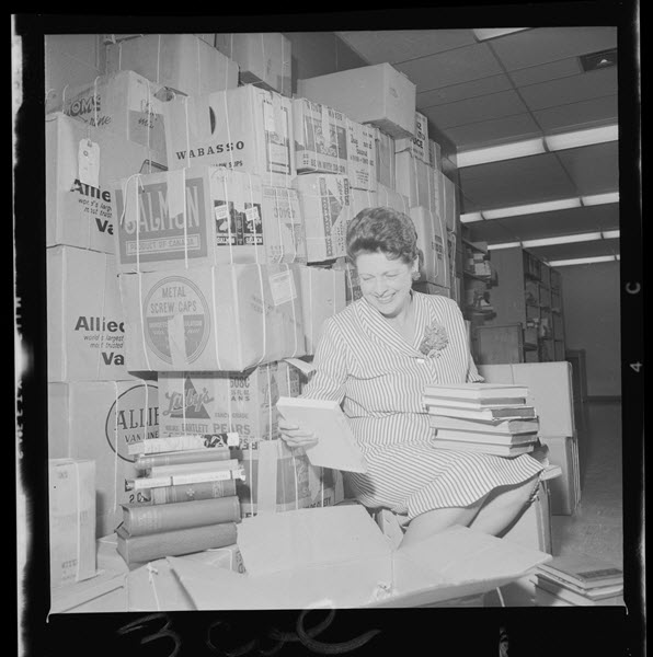 Doris Lewis with books from the Lady Aberdeen Collection.