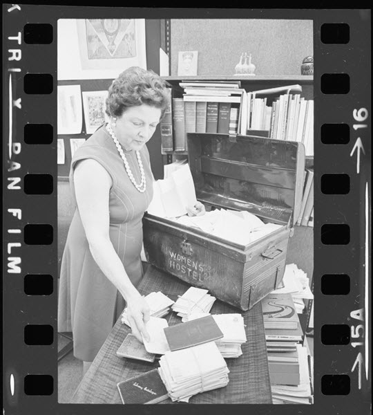 Doris Lewis with materials from the Lady Aberdeen Collection.