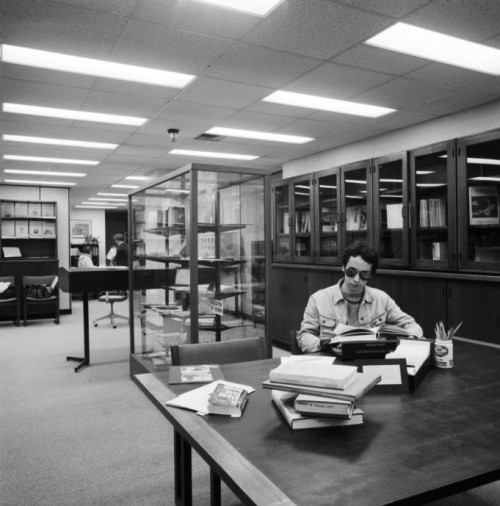 Student studying at a table in the rare book room