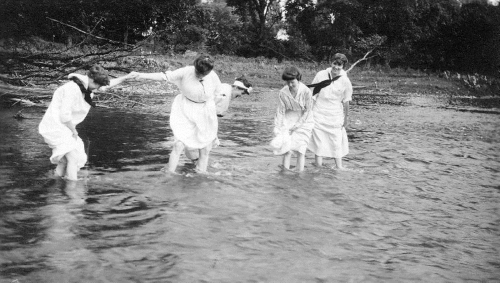 Women wading in the Grand River
