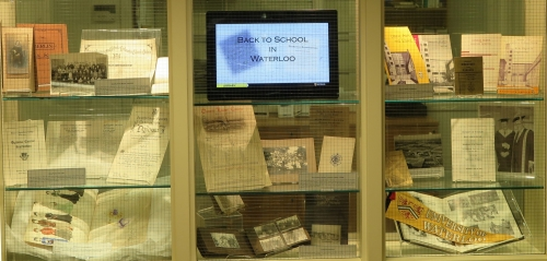 display case featuring school-related items