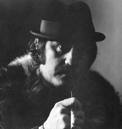 Photograph of man in fur coat