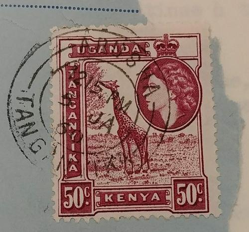 Stamp featuring a giraffe eating leaves and a profile portrait of Queen Elizabeth