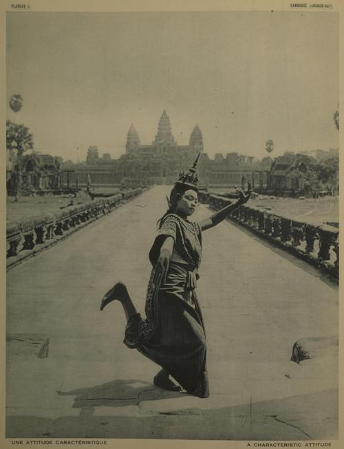 A dancer posing in front of Angkor Wat.