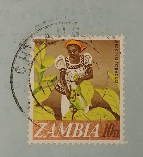 Stamp featuring labourer picking tobacco