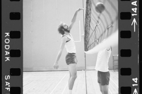 Two people practising volleyball