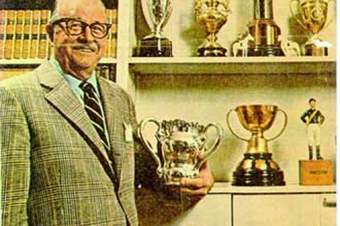 J. E. F. Seagram with the Seagram family trophies.