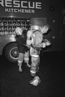 Fireman getting dressed