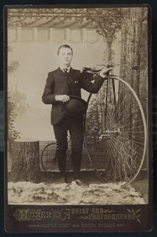 Portrait of a young man with a bicycle