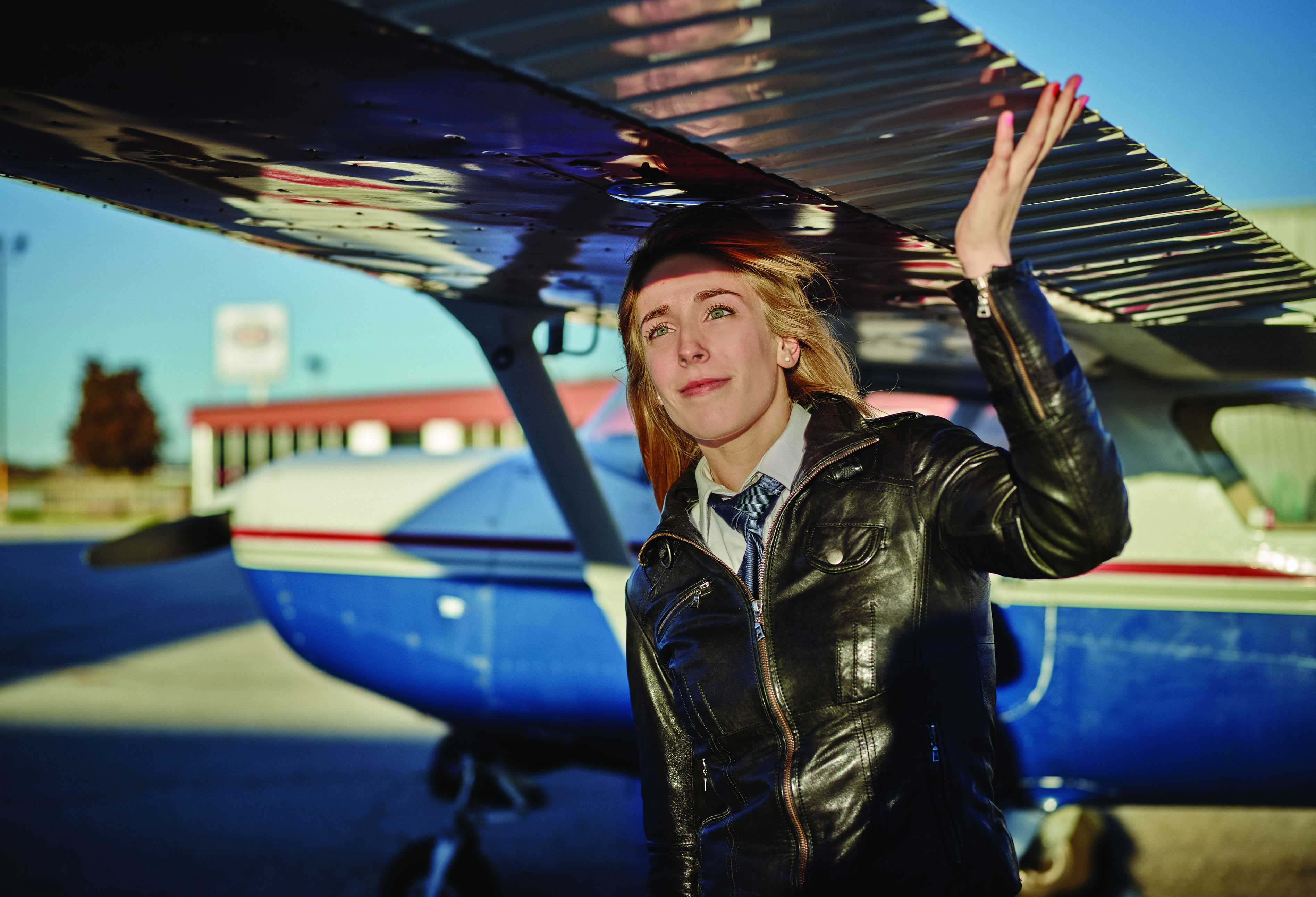 Chelsea Anne Edwards under the wings of a plane