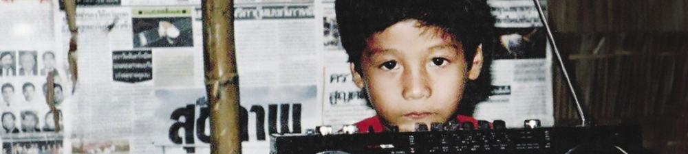 Young boy looking sad despite celebrating his birthday