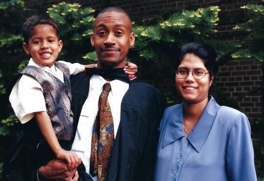 Lannois and Anandi pose with their son at convocation