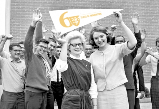 Student's from teh 1950s holding up a Waterloo banner