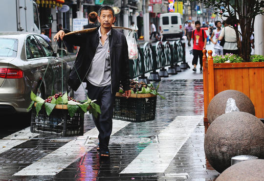 Man walking holding two baskets of food