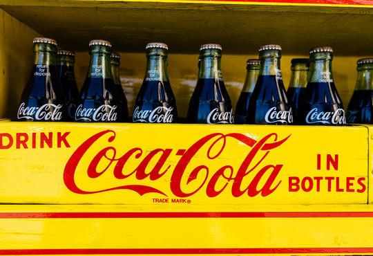 Coca-Cola bottles in crate