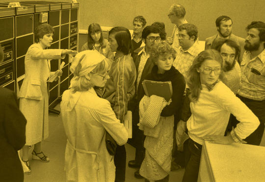 Historic photo of students and parents on a guided tour.