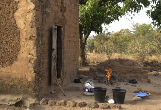 A remote African village home using fire for energy