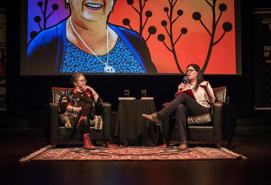 Jean Becker speaking on stage