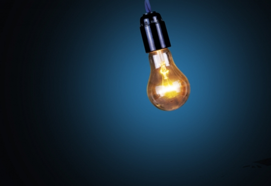 Light bulb swinging to convey the idea of power shift
