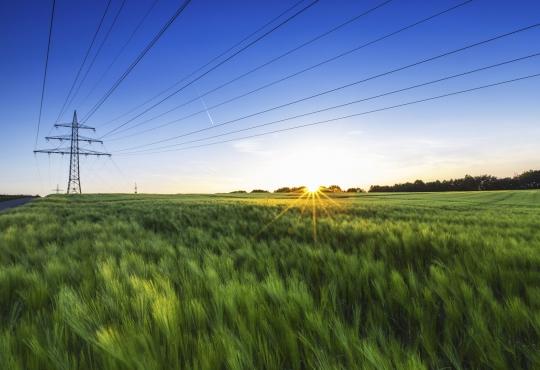 Power lines across a wide open field