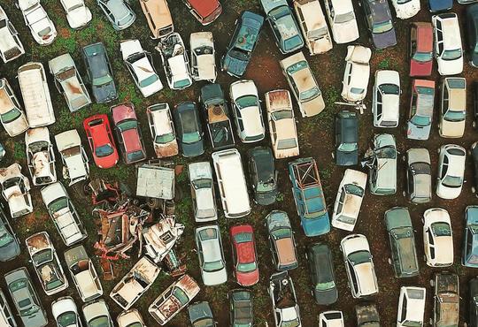 A scrapyard full of wrecked cars