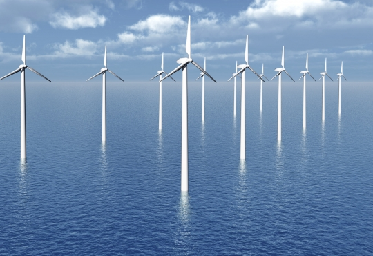 Wind turbines standing in the middle of the ocean