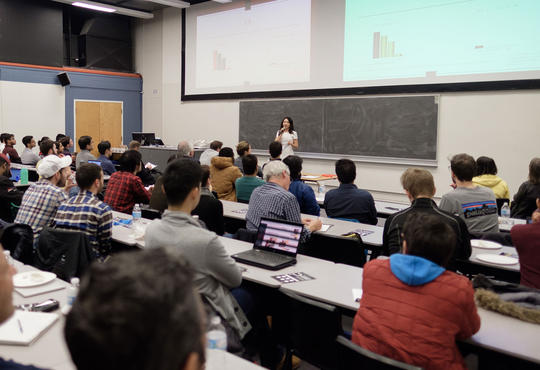 Student pitching her idea in front of a crowd