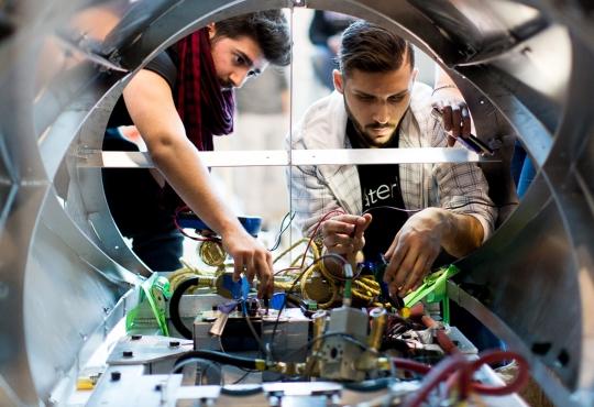 Two members of the Waterloop team work on the prototype