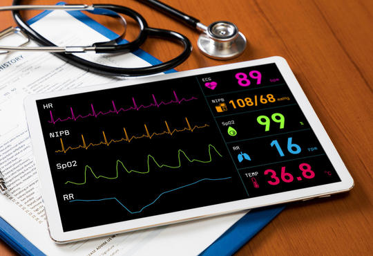 Tablet, medical chart and stethoscope