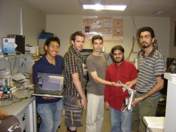 Students who created the product posing with the machine