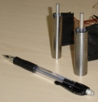 Pen next to the micro energy harvesters to show size