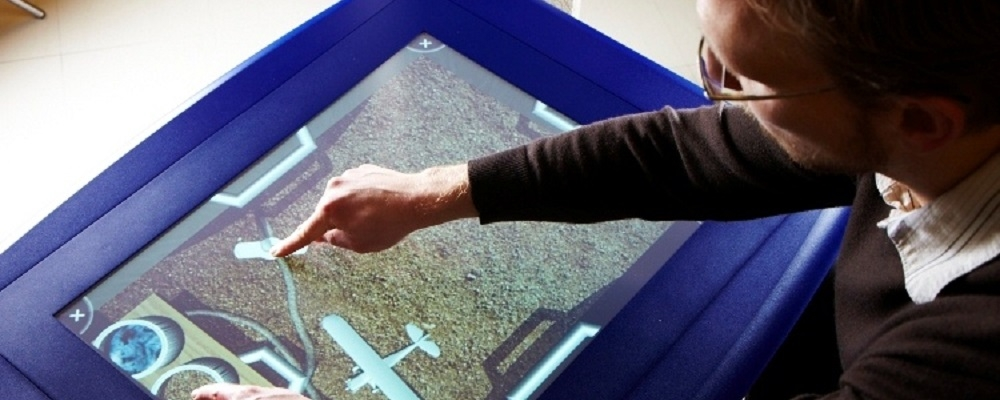 Faculty member Mark Hancock using a touch screen