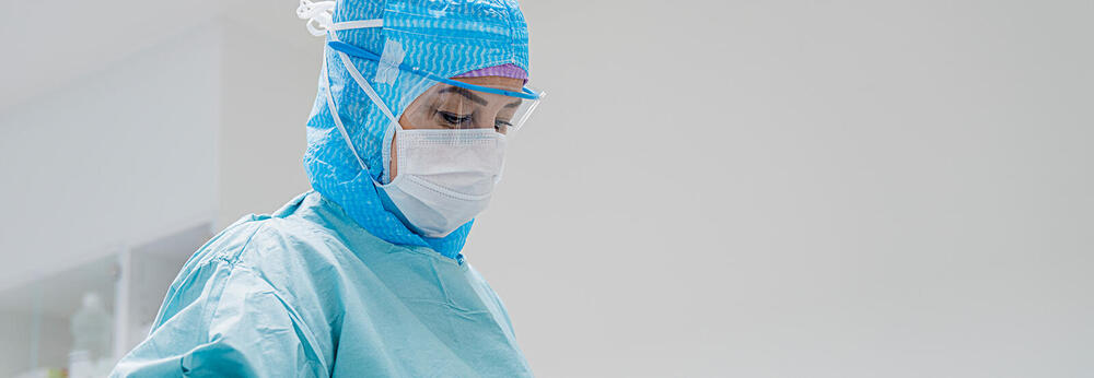 Lady dressed in personal protective equipment
