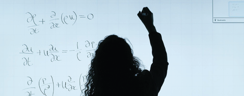silhouette of girl writing on white board