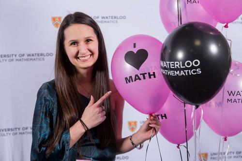 Girl holding I love math balloon