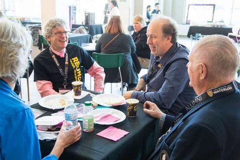 Attendees enjoying pancake breakfast